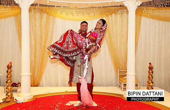 Fun post wedding couples portrait in the mandap