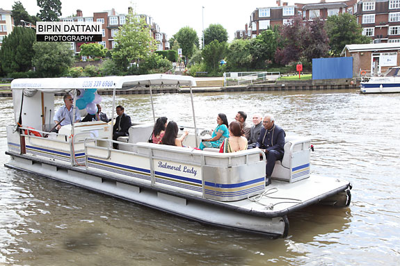 Dipen arriving by boat at wedding venue in kingston