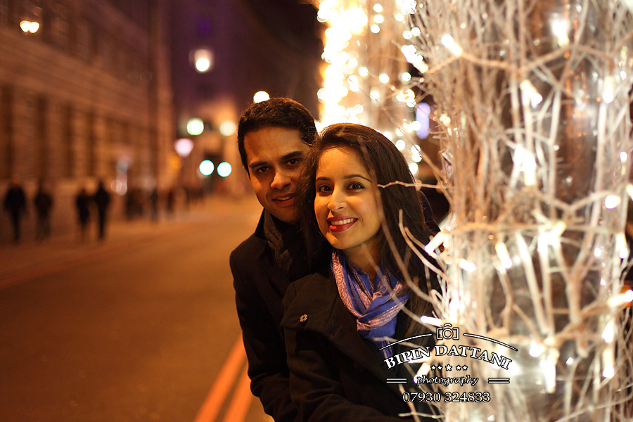 a night time pre wedding engagement photography using London's famous skyline as a backdrop