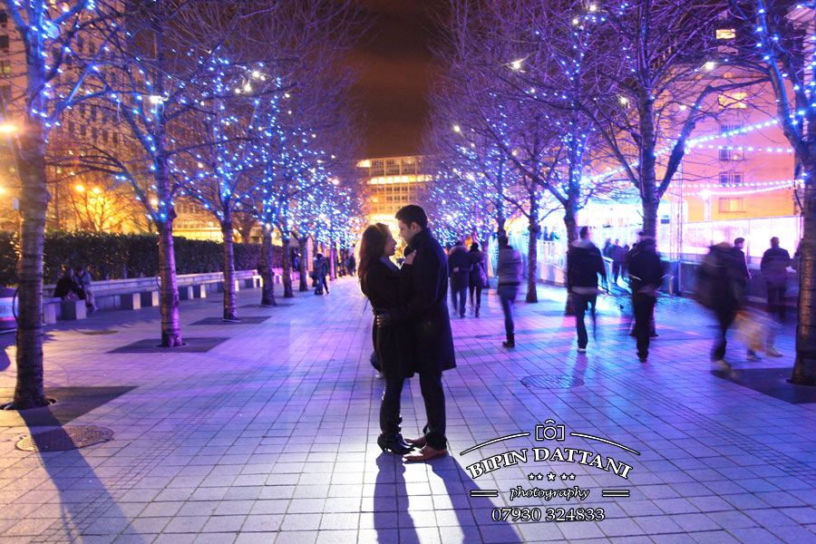 A natural engagement portrait session picture with christmas lights near London Eye