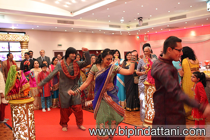Brides family perform a dancing show at groom arrival.
