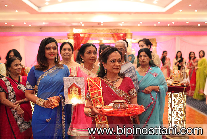 Bride's family inviting the groom to enter at The VIP Lounge in  London