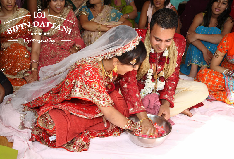 indian wedding photographer at couples home for post wedding vidhi ceremony in Harrow London