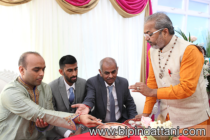 Shastri Nityananda hindu priest in London conducting engagement ceremony harrow