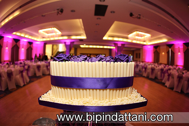 White chocolate with purple roses as toppers