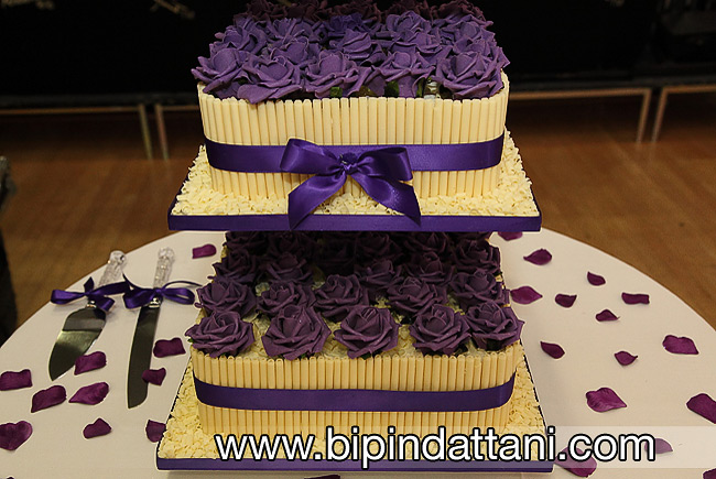 elegant wedding cake with flowers purple roses