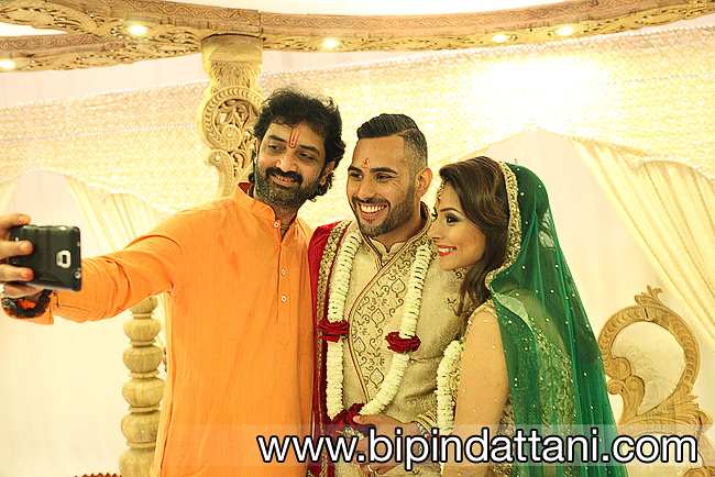 Pandit Piyushbhai with his Hindu priest services in London taking selfie with bride and groom