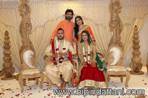 Piyushbhai Indian wedding priest from Jalaram Mandir Greenford London with wife and happy coup;e after wedding