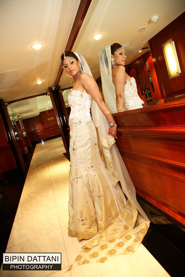 bride posing directed by Bipin Dattani at Edwardian Heathrow Hotel, Hayes UB3 5AW