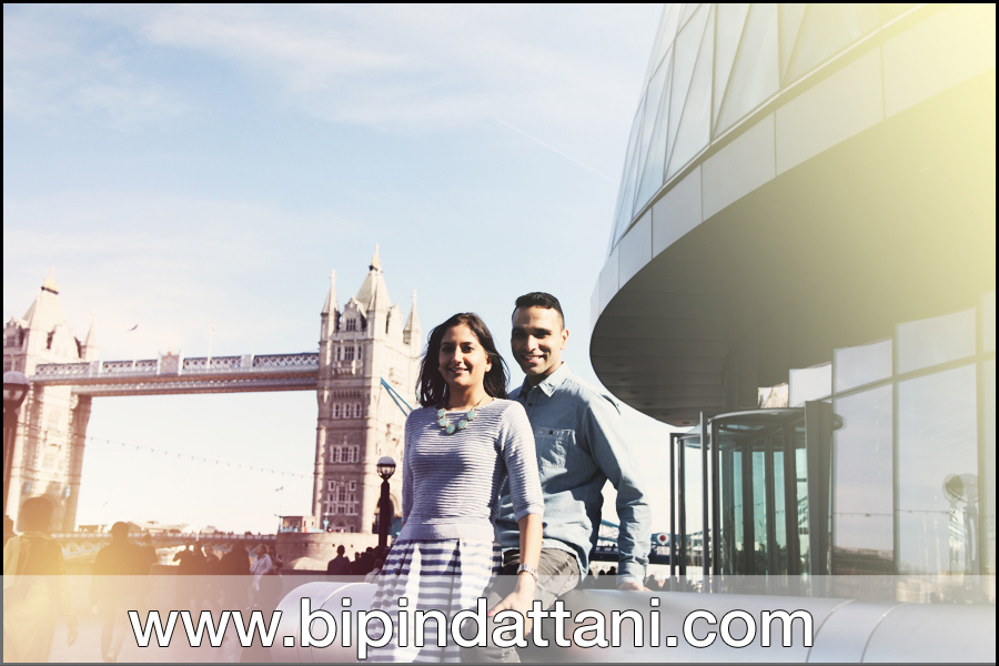 pre wedding couple's photo by top london wedding photographers near city hall on the Thames