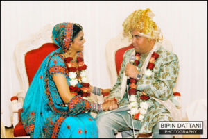 North Indian couple in mandap wedding ceremony