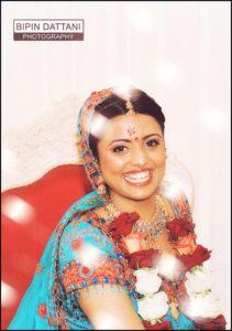 happy asian bride in mandap manor of groves wedding