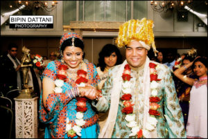 happy married indian couple after wedding vows