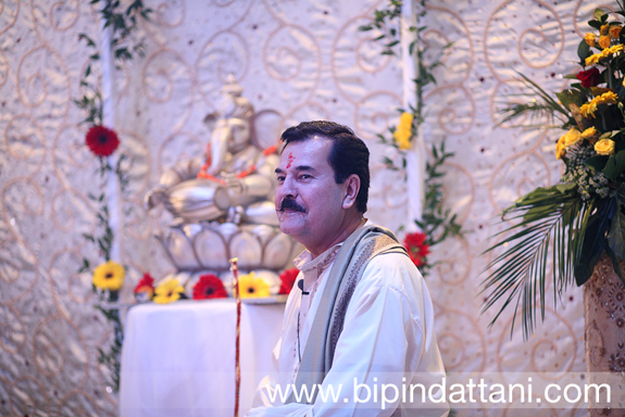 Smiling Rajubhai Mehta Priest at pre wedding mandvo ceremony in london