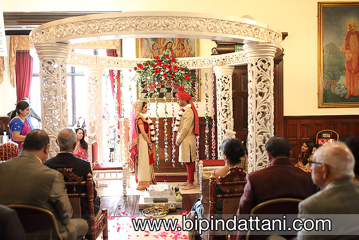 Khiloni & Amish saying marriage vow hare krishna temple wedding in mandap