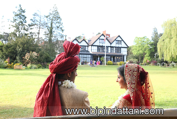 indian wedding photographer couple portraits with the hare krishna templele watford