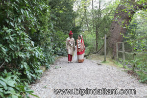 natural couple portraits in the grounds Bhaktivedanta Manor by best indian wedding photographer london