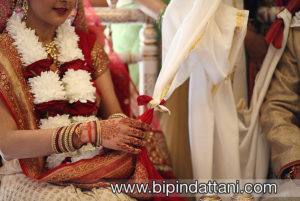 the knot tying rite at hindu temple wedding
