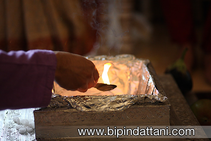 lighting the sacred fire, the Agni, by the hare krishna priest during the hindu wedding