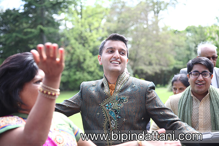 joyous guests doing band baaja wedding garba at groom's entrance