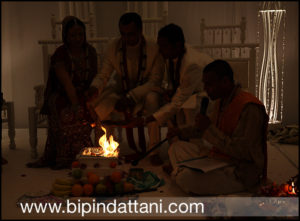 Brahmin kama pandey hindu priest performing agni ceremony dipa sandeeps wedding
