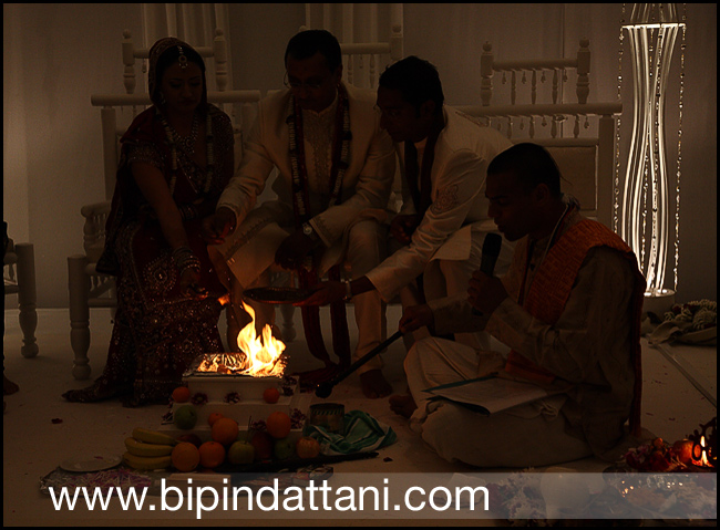 Brahmin kamal pandey hindu priest performing agni ceremony dipa sandeeps wedding