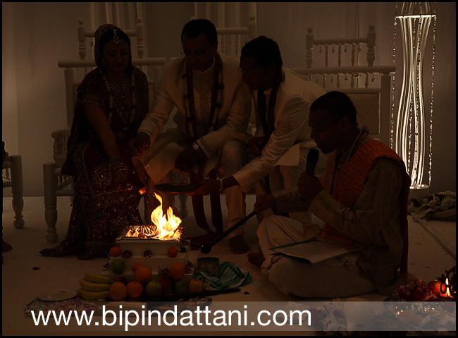 Brahmin kamal pandey hindu priest performing agni ceremony dipa sandeeps wedding