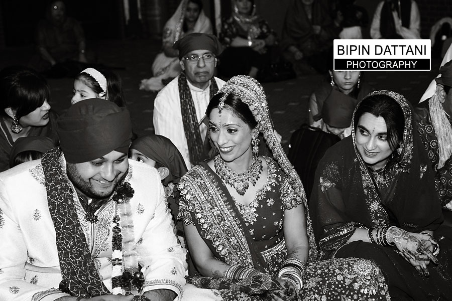 Natural Sikh wedding ceremony photography of bride and grrom in Southall Gurdwara in Black & White