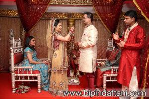 the fresh flower haar or garland Tanvi puts on Jatten at Hindu wedding ceremony