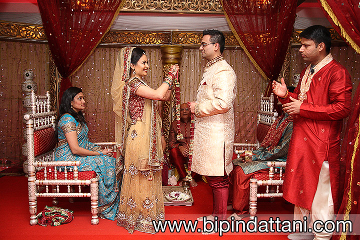 the fresh flower haar or garland Tanvi puts on Jatten at Hindu wedding ceremony