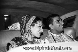 couple in wedding car after vidai indian wedding at Hammermith Novotel