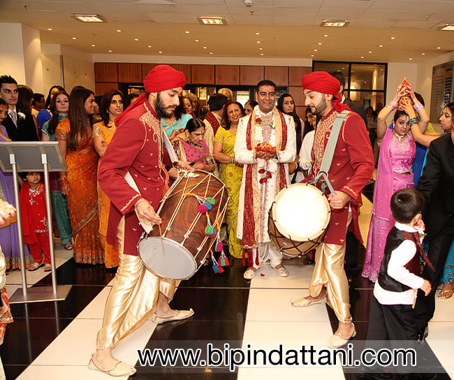 grooms arrival with dhol players at novotel hammersmith London