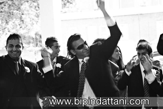 indian wedding groom arrival celebration Image by Bipin Dattani Photography