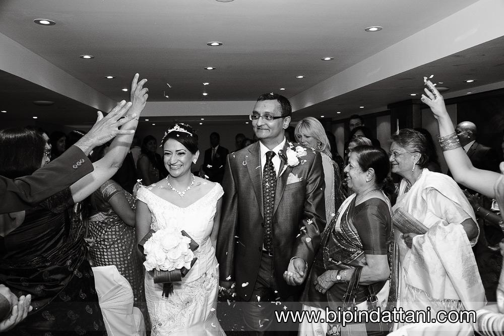 happy couple leaving official registry wedding kensington