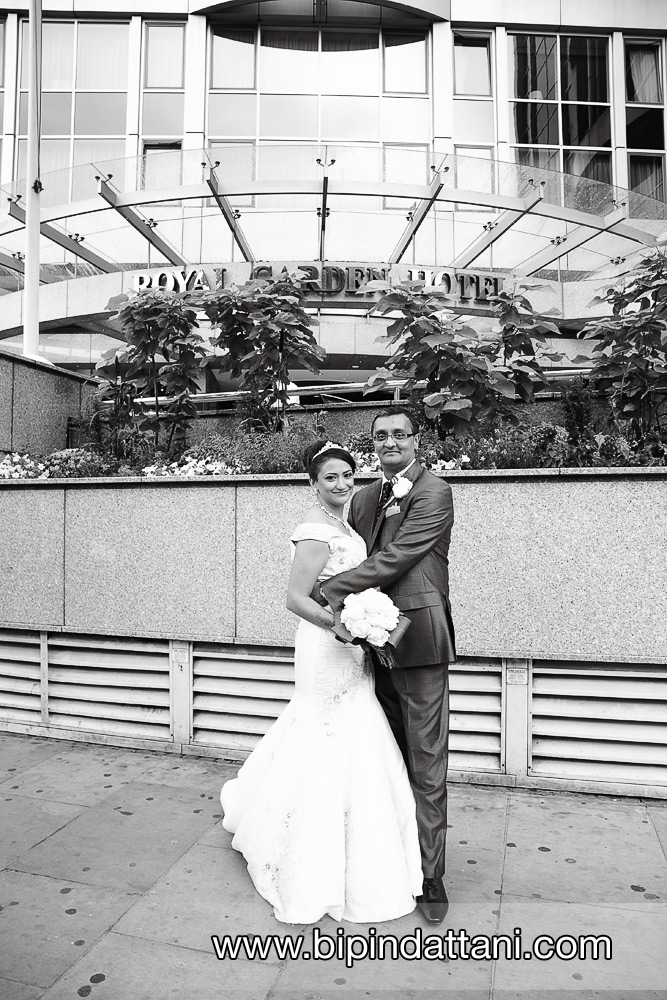married couple wedding portraits outside luxury Royal Garden Hotel London
