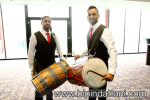 Dhol Players preparing drums for groom's entrance at wembley hilton London