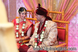 happy indian bride and groom discussing wedding ceremony natural wedding picture