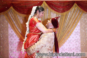 bride carried by groom after wedding captured by professional indian wedding photographer at Saffron D'or Southall UB1