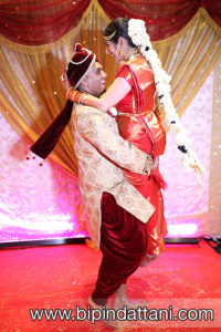 happy bride & groom pictures after wedding by Indian wedding photographers London