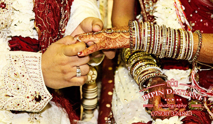 Wedding ring exchange Indian wedding photographers Chiswick Hounslow Ealing LONDON W4