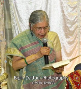 female Hindu priest London UK portrait