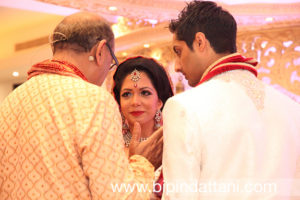 Vasudev Mehta with bride and groom