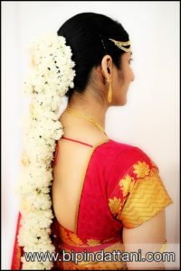 south indian bridal hairstyle with flowers for weddings