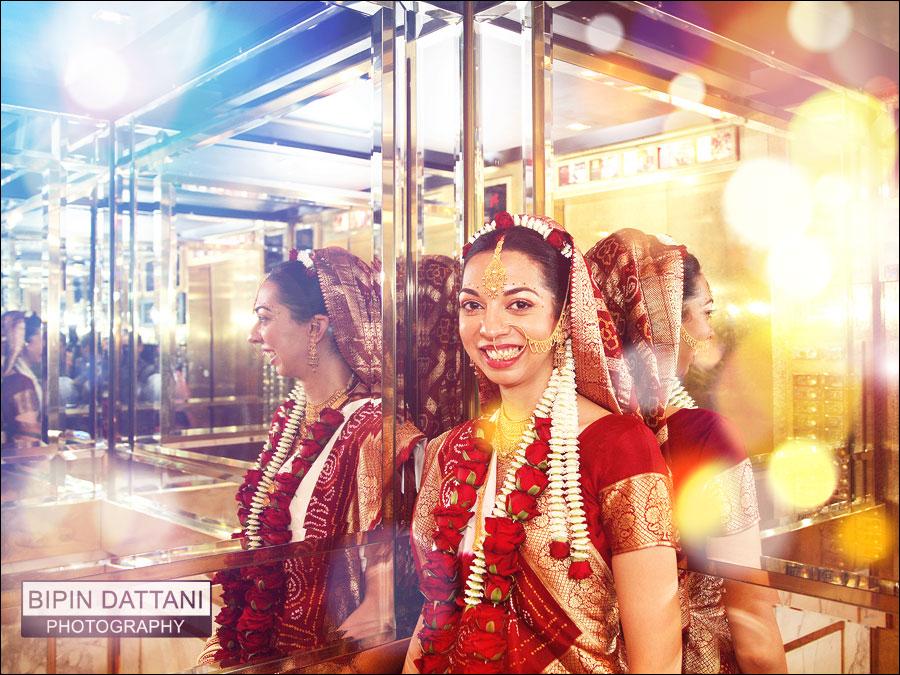 happy bride's portrait by Bipin Dattani the gujarati ceremony wedding photographer