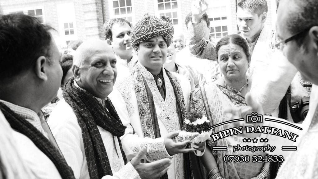 hindu groom's entrance picture by indian wedding photographer Bipin Dattani of London
