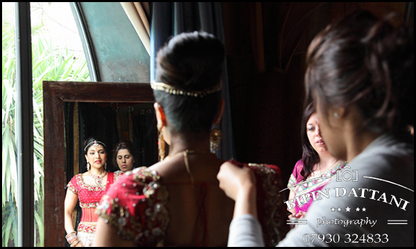 Bride looing stunning in her indian wedding dress at her destination wedding in morocco