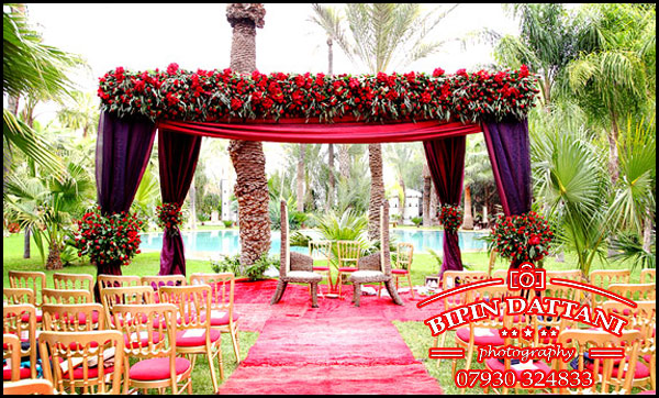 Red flowers mandap setup for indian wedding in Marrakech