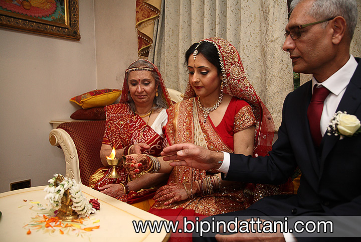 Khiloni performing the ganesh puja at the start on the indian wedding ceremony