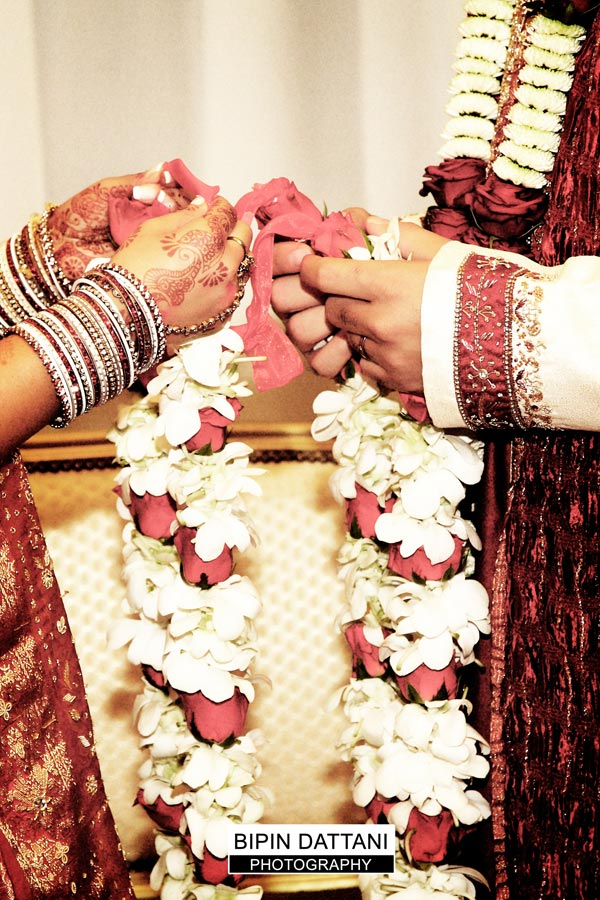 exchanging garlands at indian wedding whipsnade zoo bedfordshire