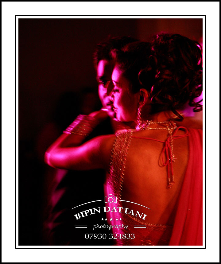indian couple in romantic first dance cpatured naturally by London Indian Wedding Photographer